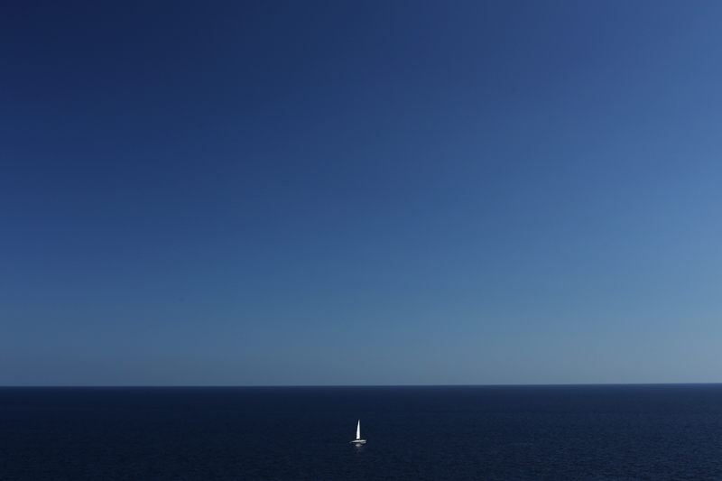 solitary boat in the mediterranean sea